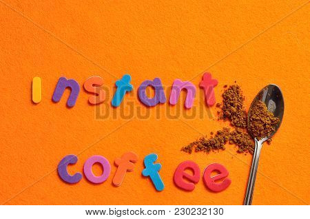 A Teaspoon Of Instant Coffee With The Words Instant Coffee On An Orange Background