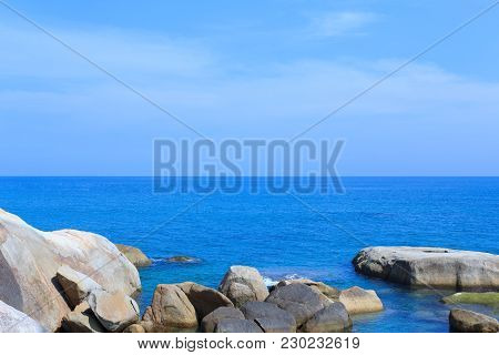 Stone And Sea On Blue Sky Background.  Ko Samui, Surat Thani Province, Thailand.