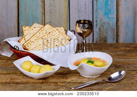 Traditional Jewish Homemade Matzo Ball Soup In A Bowl Passover Wine And Matzah