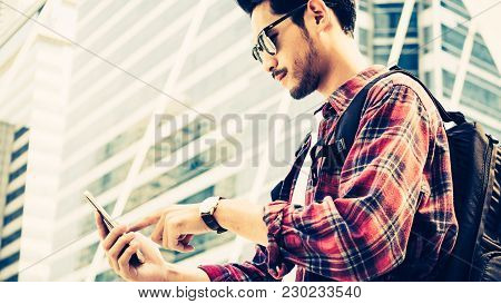 Asian Traveler Man Is Walking On City Street And Looking At Interesting Places To Travel From Smart