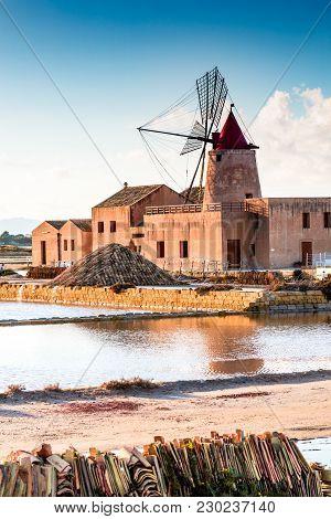 Marsala, Italy. Stagnone Saline Lagoon With Vintage Windmills And Saltwork, Trapani Province, Sicily