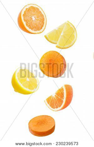 Isolated Falling Fruits. Falling Orange, Limon And Carrot Isolated On White Background With Clipping