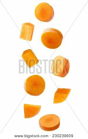 Isolated Falling Vegetables. Falling Carrot Isolated On White Background With Clipping Path As Packa