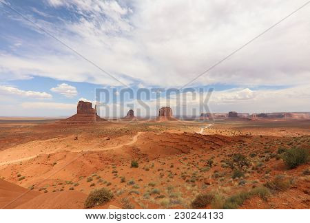 Panorama With West Mitten Butte, East Mitten Butte And Merrick Butte In Monument Valley. Arizona. Us