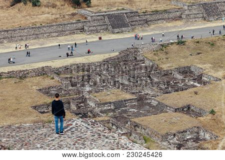 Man Looks At Ancient Ruins And The Road Of The Dead. Teotihuacan. Mexico City. Mexico