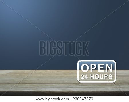 Open 24 Hours Icon On Wooden Table Over Light Blue Gradient Background