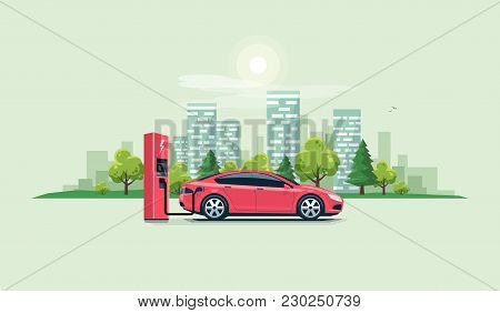 Electric Car Charging At The Charging Station With City