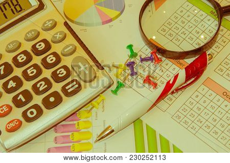 Graphics Calculator, Magnifier And Pen. Analyzing Financial Data And Counting On Calculator. Sales E