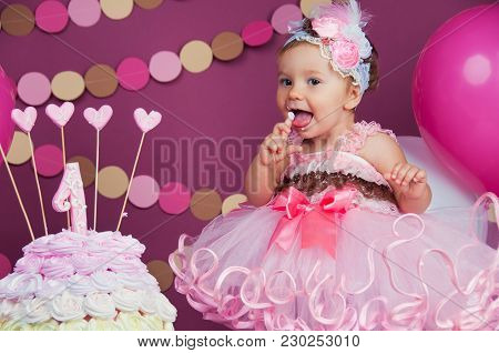 Portrait Of A Little Cheerful Birthday Girl With The First Cake. Eating The First Cake. Smash Cake.
