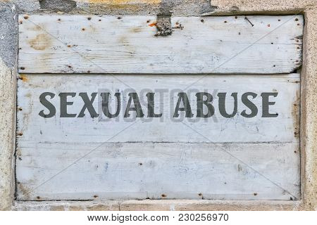 Text Sexual Abuse Written On Vintage Wooden Background