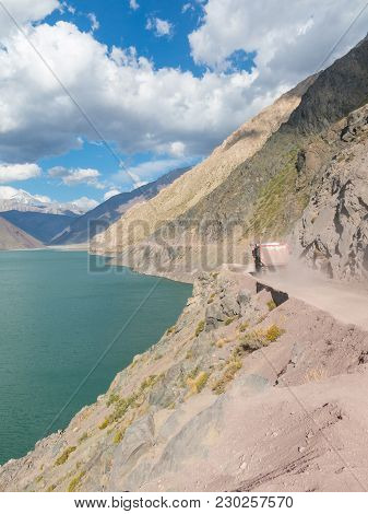 A Truck That Transports Sand Crosses The Road Of The Maipo Canyon And The Lake Of Yeso. Cajon Del Ma