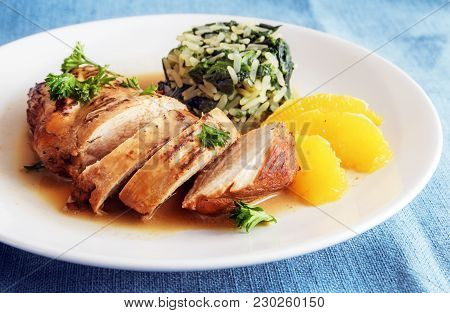 Chicken Breast With Orange Slices And Spinach Rice On A White Plate, Diet Dinner With Low Calories,