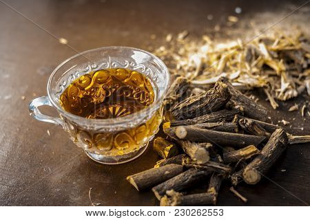 Ayurvedic Herb Liquorice Root,licorice Root, Mulethi Or Glycyrrhiza Glabra Root And Its Powder With