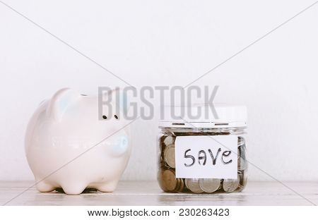 Bottles Of Cash With Coins - Save Money Concept