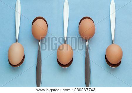 Repeated Pattern Of Eggs Leaning On Spoons, Pastel Colors, Tableware