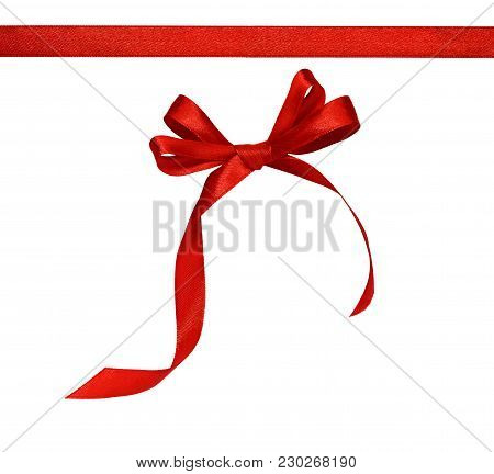 Red Silk Ribbon And A Bow Isolated On White Background