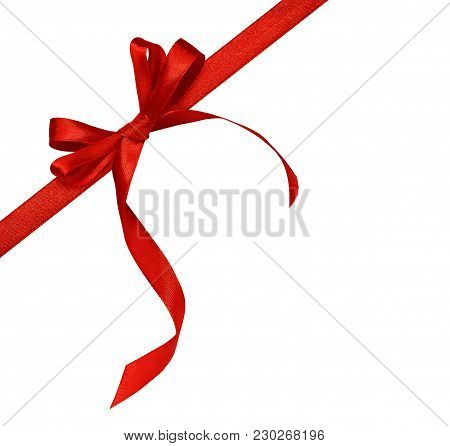 Red Silk Ribbon And A Bow Isolated On White Background. Corner Arrangement.