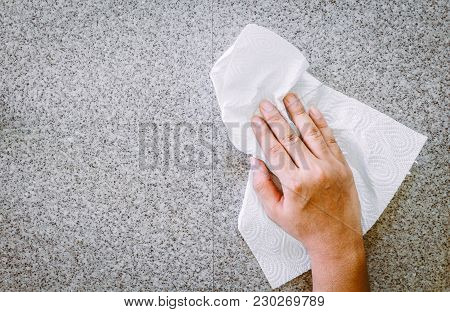 Hand Cleaning With Paper Towel In Kitchen