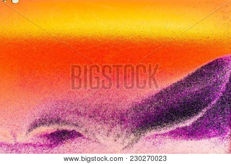 Colorful Sand Pigments Falling Down In Water. Abstract Landscape Background.