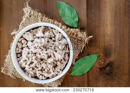 Minced Meat On A Brown Wooden Table