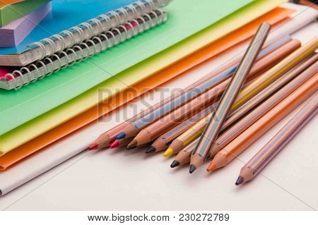 Pencils Folders And Notebooks On The Office Table