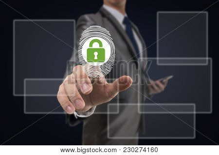 Businessman Fingerprint Scan And Pressing Modern Technology Lock Security Over The Dark Blue Backgro