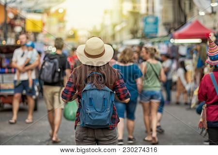 Back Side Of Young Asian Traveling Women Walking And Looking In Khaosan Road Walking Street In Eveni