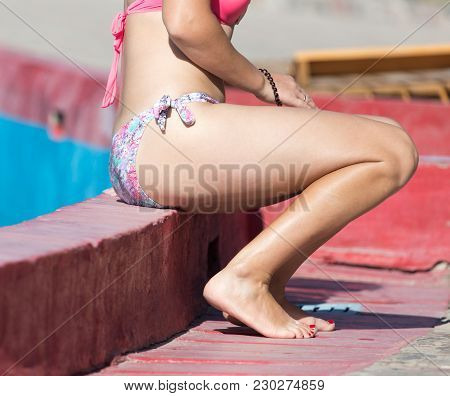 Girl In A Bathing Suit In The Water Park .