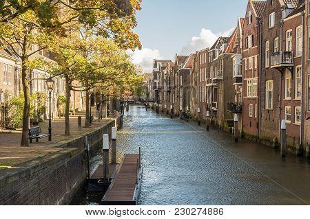 Dordrecht, Netherlands - October 27, 2017: Voorstraatshaven And Grote Kerk On A Sunny Afternoon. The