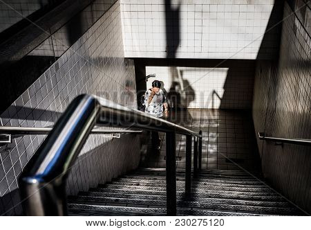 New York, Usa - Sep 23, 2017: Manhattan Street Scene. Light And Shadows In New York City. Woman Come