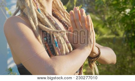 Close-up Hands Of Young Woman Doing Asana Yoga With Namaskar Gesture At Backyard Of Her House.