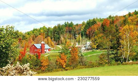 Beautiful Vermont Farm Landscape In Autumn With Red Barn And Fall Foliage
