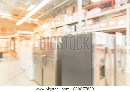 Blurred Row Of Brand New Fridges At Retail Store In Usa