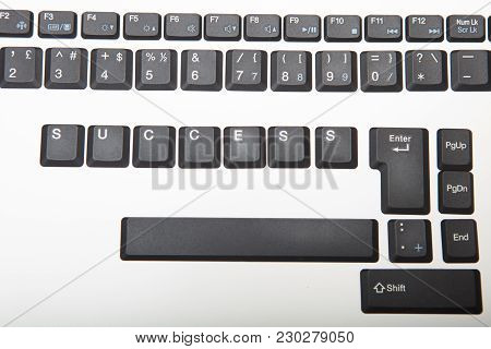 Adapted Computer Keyboard Composed Of Loose Key Covers From A Computer With The Word Success And Dig