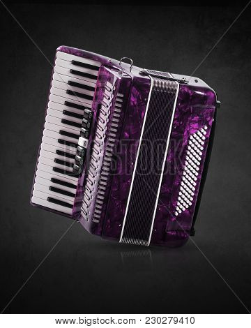 Part Pink Accordion On Grey Background. Write Text.