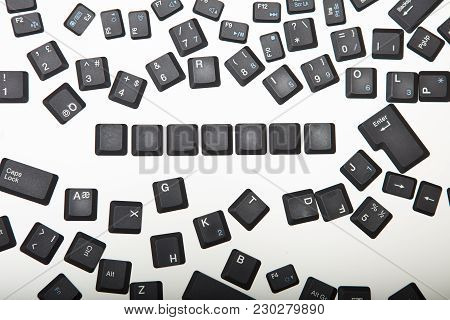 Loose Scattered Alphanumeric And Function Key Covers From A Laptop Computer Keyboard With A Line Of