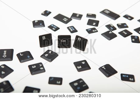Computer Keyboard Composed Of Loose Key Covers From A Computer With The Three Keys In A Close Up Hig