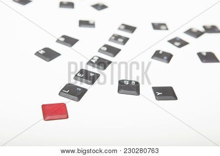 Conceptual Image Of Leadership And Individuality With Loose Grey Key Covers From A Laptop Keyboard S