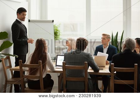 Black Company Ceo In Suit Discussing Business Strategy Presentation At Meeting With Young And Senior