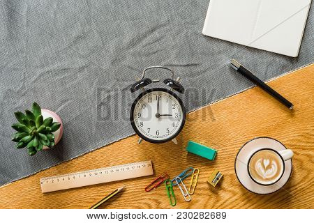 Change To Daylight Saving Time Photo Of Alarm Clock With Copyspace On Blank Notebook And Office Supp