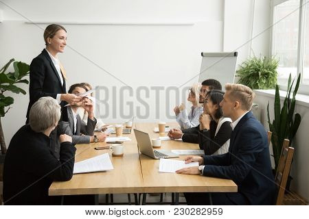 Successful Female Boss Leading Team Meeting Talking To Multiracial Employees, Woman Executive Leader