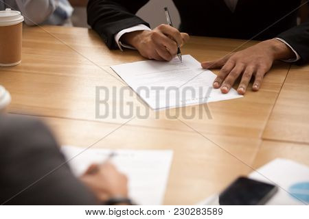 Businessman In Suit Signing Business Contract At Meeting, Entrepreneur Putting Written Signature Fil