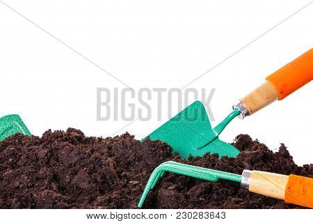 Gardening tool in soil isolated on white.