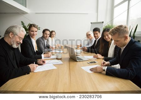 Senior And Young Businessmen Sign Contracts At Group Multiracial Meeting, Experienced Investor Buyin