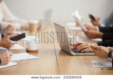 Business People Sitting Together At Conference Table Office Desk Using Laptops And Smartphones Worki