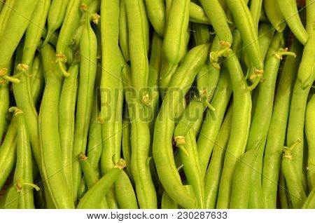 Bean Pods Are Stacked Parallel To Each Other As A Background.