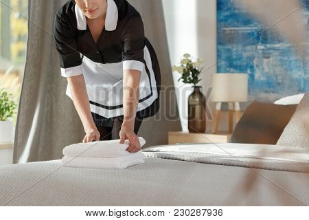 Chambermaid Preparing Hotel Room