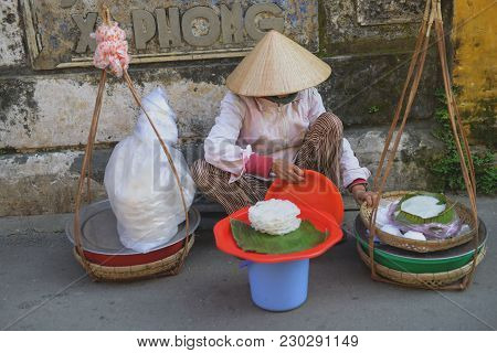 Hoi An, Vietnam - 8 February 2018: Vietnamese food vendor selling traditional noodles on a street si