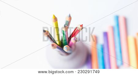 Bunch Of Multicolored Cpencils In Cup Chalks. Top View White Background. Education Arts Crafts Creat