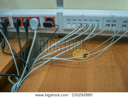 Electronic Equipment Wires And Usb Connectors Connected To Sockets And Connectors In The Data Center